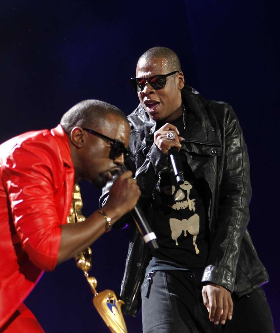 Kanye West, left, and Jay Z perform during