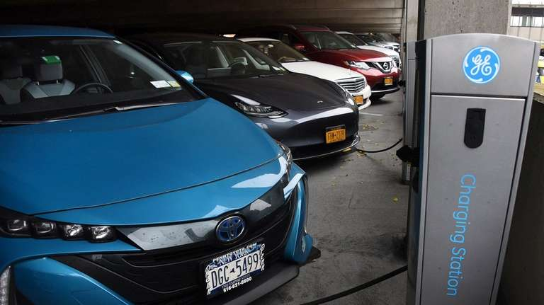 Electric vehicles are hooked up to charging stations