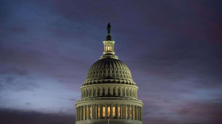 The U.S. Capitol dome is seen at sunrise