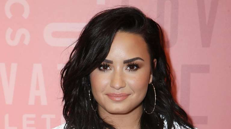 Demi Lovato attends a Fabletics event at the