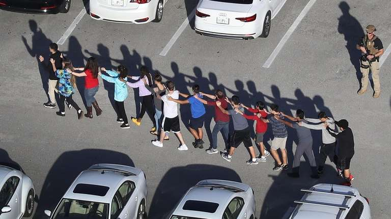 People are brought out of Marjory Stoneman Douglas