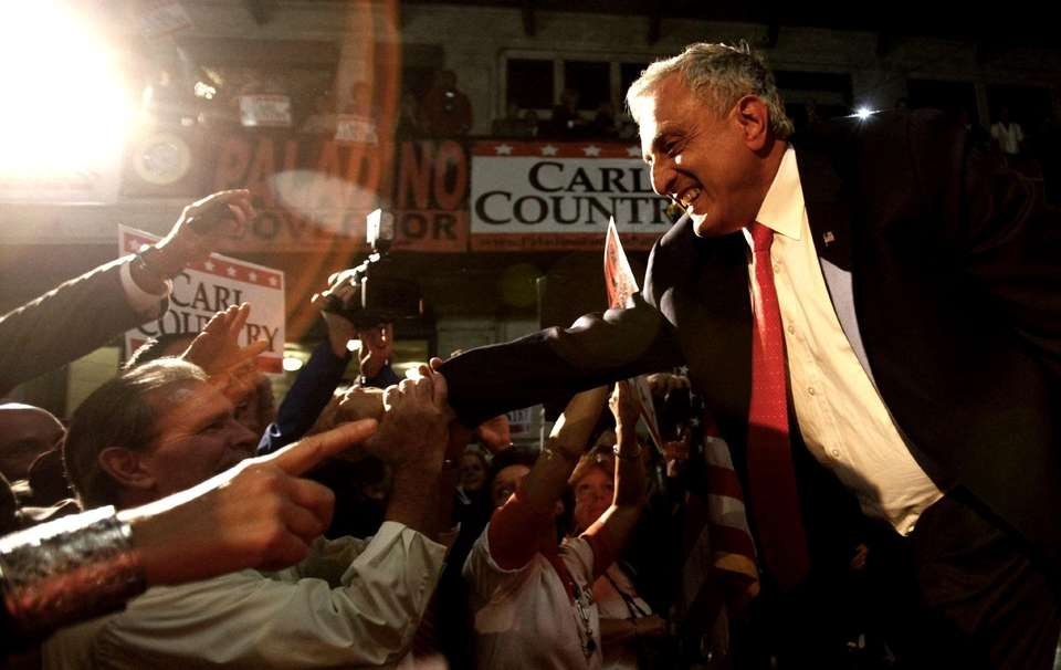 GOP gubernatorial candidate Carl Paladino celebrates in the