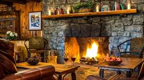 A fire roars in the lounge area of