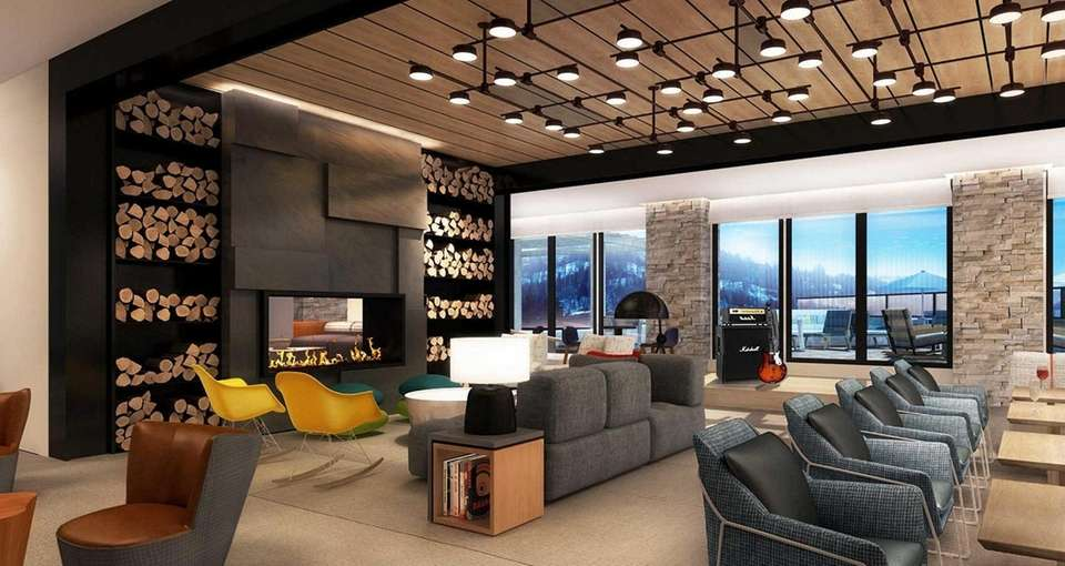 A rendering shows the lounge area at the