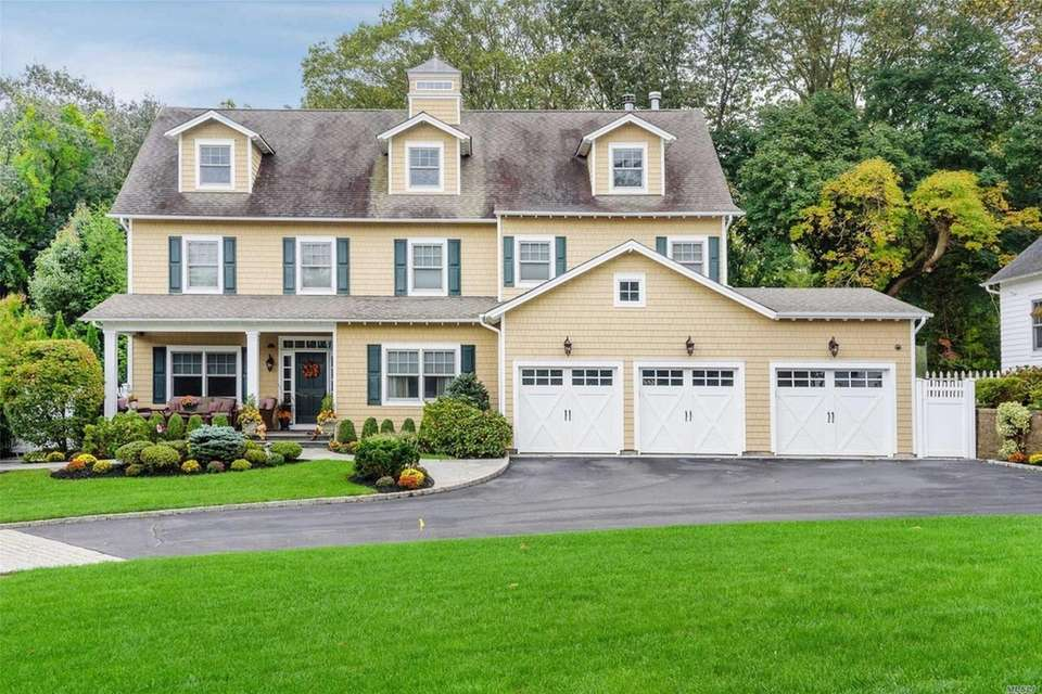 This Locust Valley Colonial includes four bedrooms and
