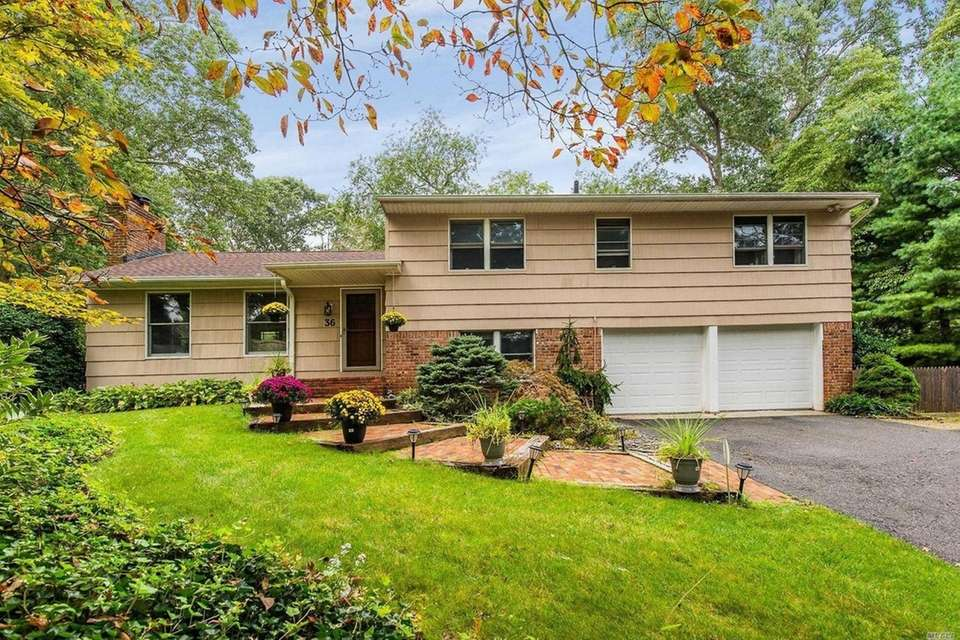 This Huntington Station split-level includes four bedrooms and