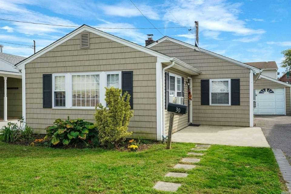 This Massapequa ranch includes three bedrooms and one