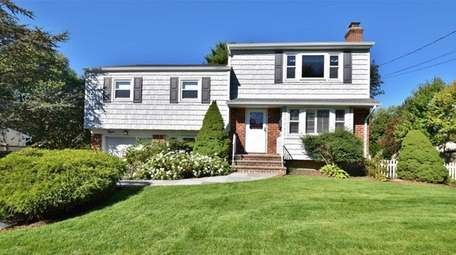This split-level, with five bedrooms and 1-1/2 bathrooms,