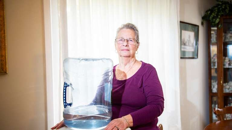 Homeowner Lucille Morreale with the bottled water dispenser