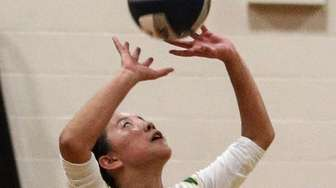 Ami Carey of Lynbrook sets for her team
