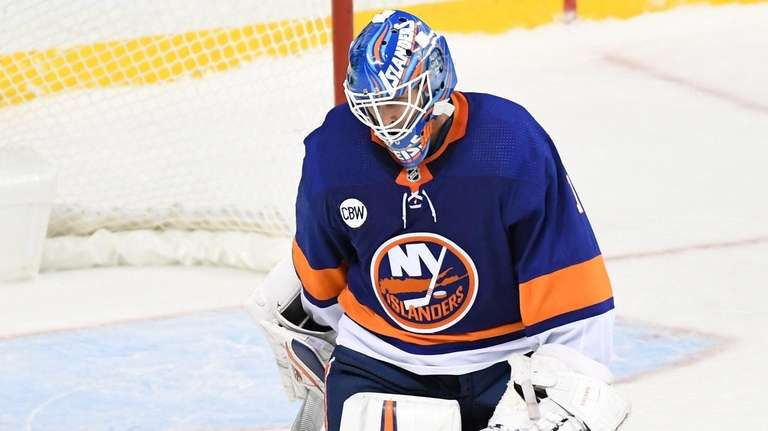 Islanders goaltender Thomas Greiss skates off the ice