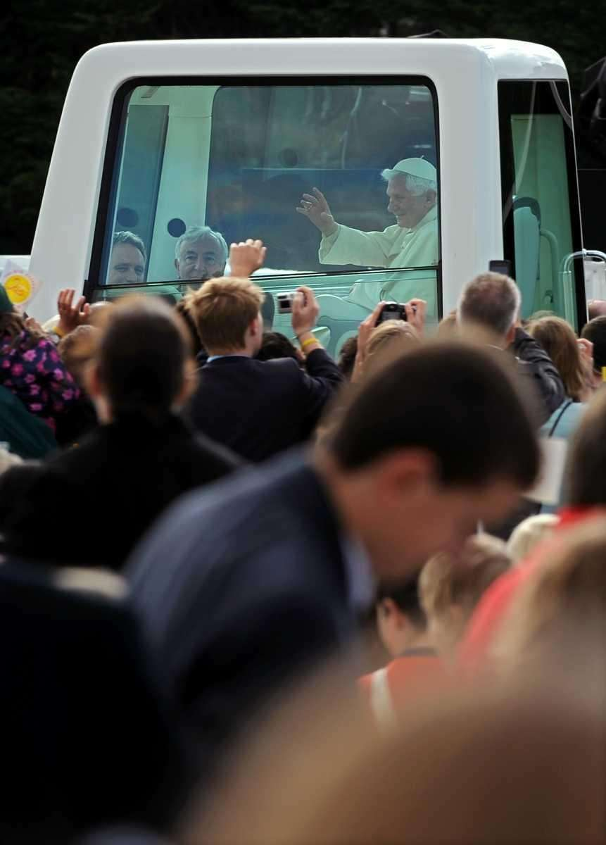 Pope Benedict XVI greets the crowd as he