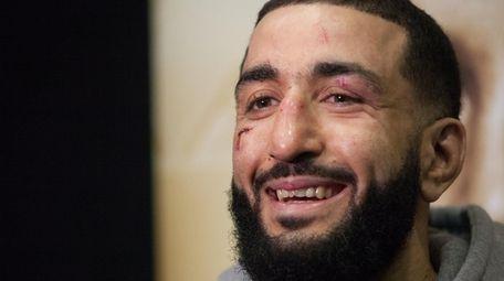 Belal Muhammad talks to the media after winning