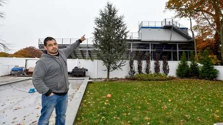 Chris Cannella points to bleachers at North Babylon
