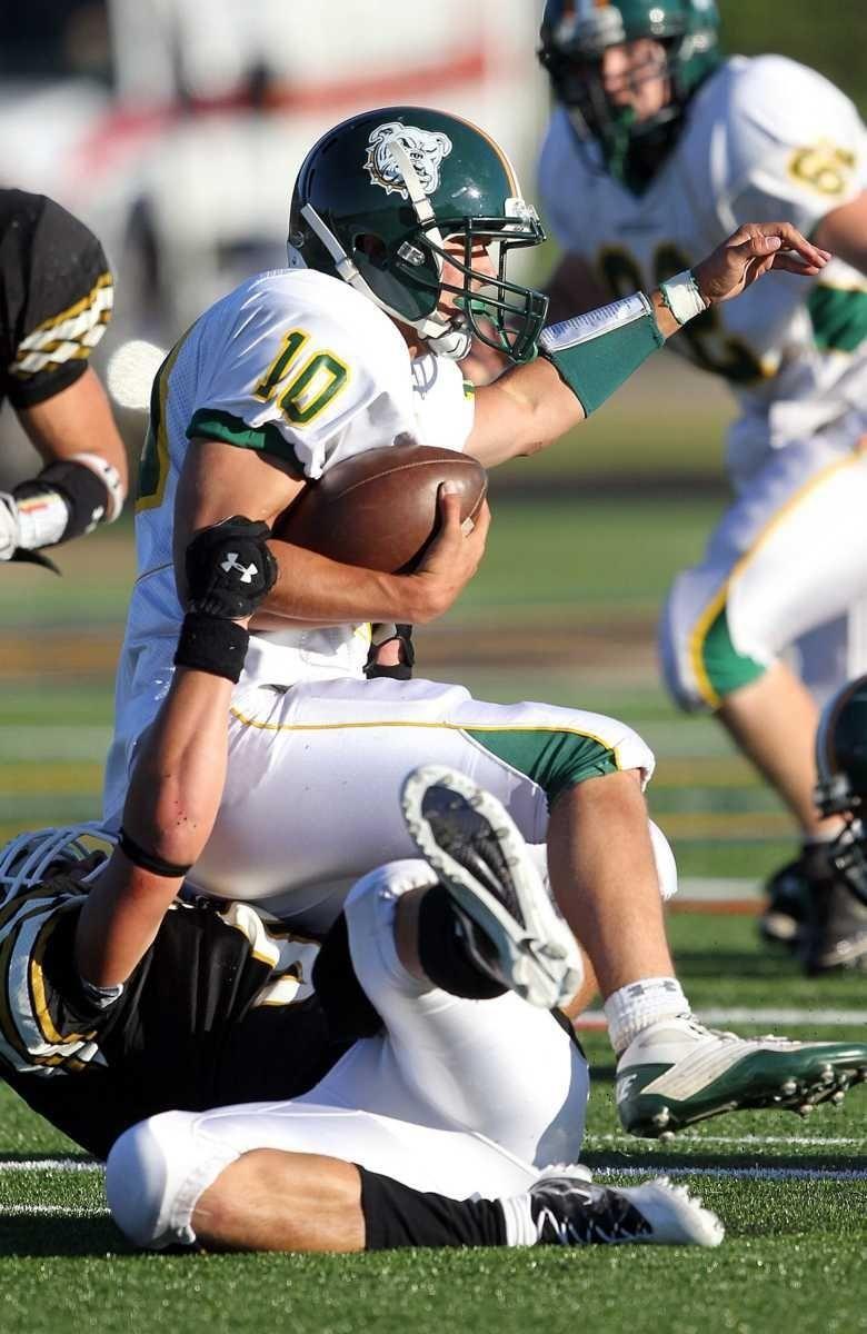 Lindenhurst quarterback Steve Skon (10) is sacked in