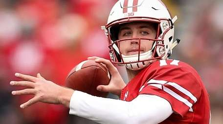 Jack Coan of Wisconsin throws a pass in