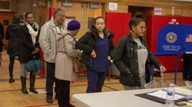 Voters cast their ballots at Atkinson Elementary School