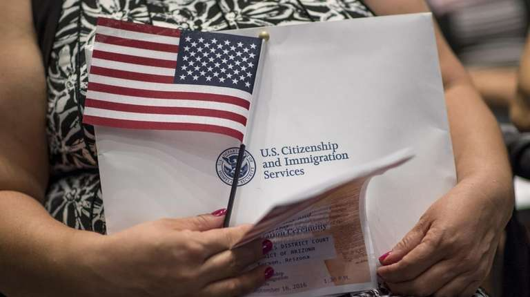 An applicant for U.S. citizenship holds an American
