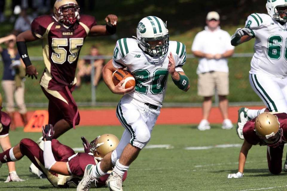 Holy Trinity's Michael Williams breaks free against Iona