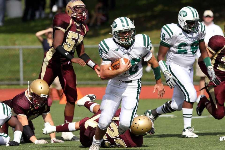 Holy Trinity's Michael Williams gains yards against Iona