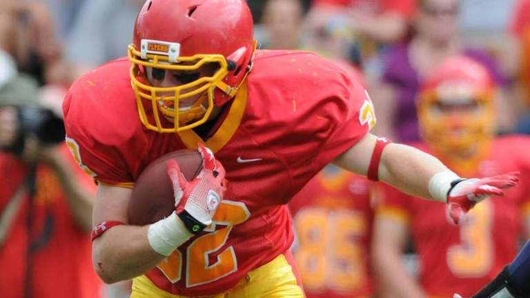 Chaminade running back #32 Daniel Fowler rushes for