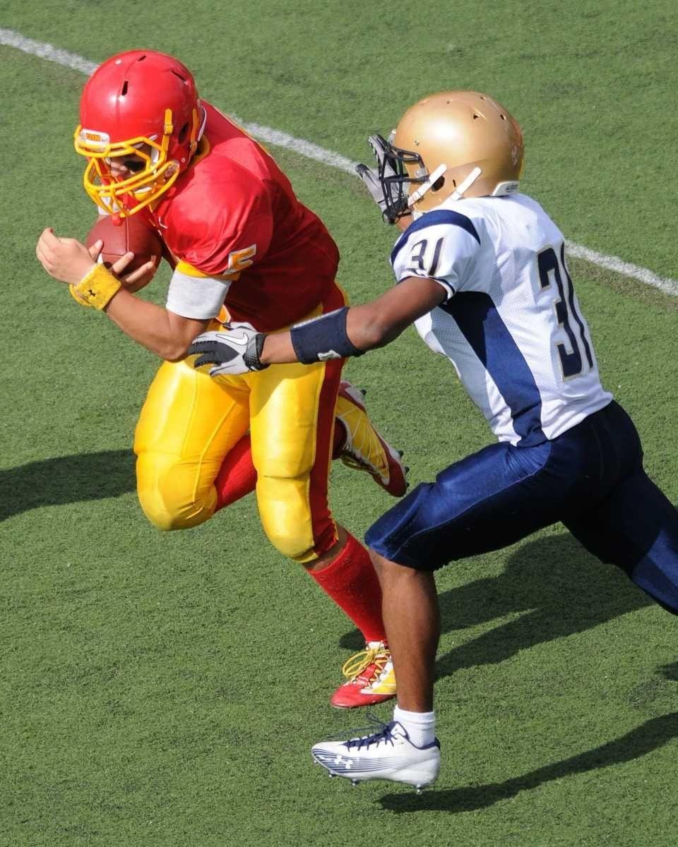 Chaminade quarterback #5 Joseph Anile IV, left, scrambles