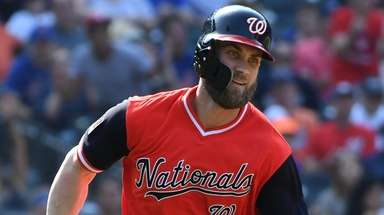 Nationals centerfielder Bryce Harper follows runs on his