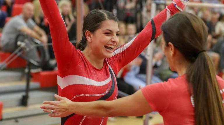Amanda Pisano of Connetquot is congratulated by her