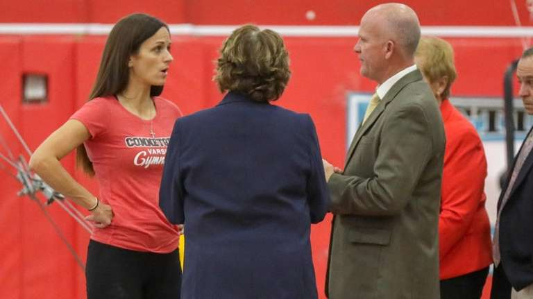 Meet officials speak with Connetquot coach Renee Guerrieri