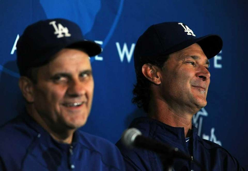 Manager Joe Torre (L) and coach Don Mattingly