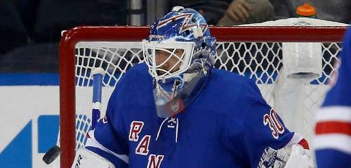 Rangers goalie Henrik Lundqvist makes a save during