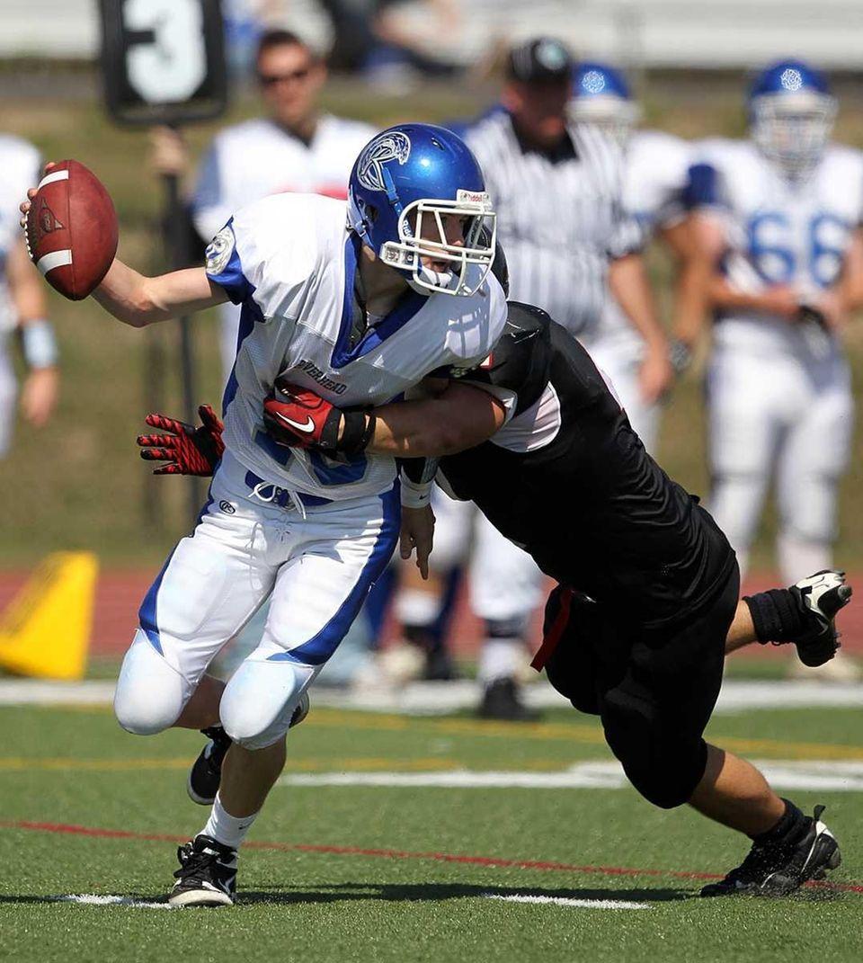 Newfield linebacker Tom Diubaldo sacks Riverhead quarterback Ryan