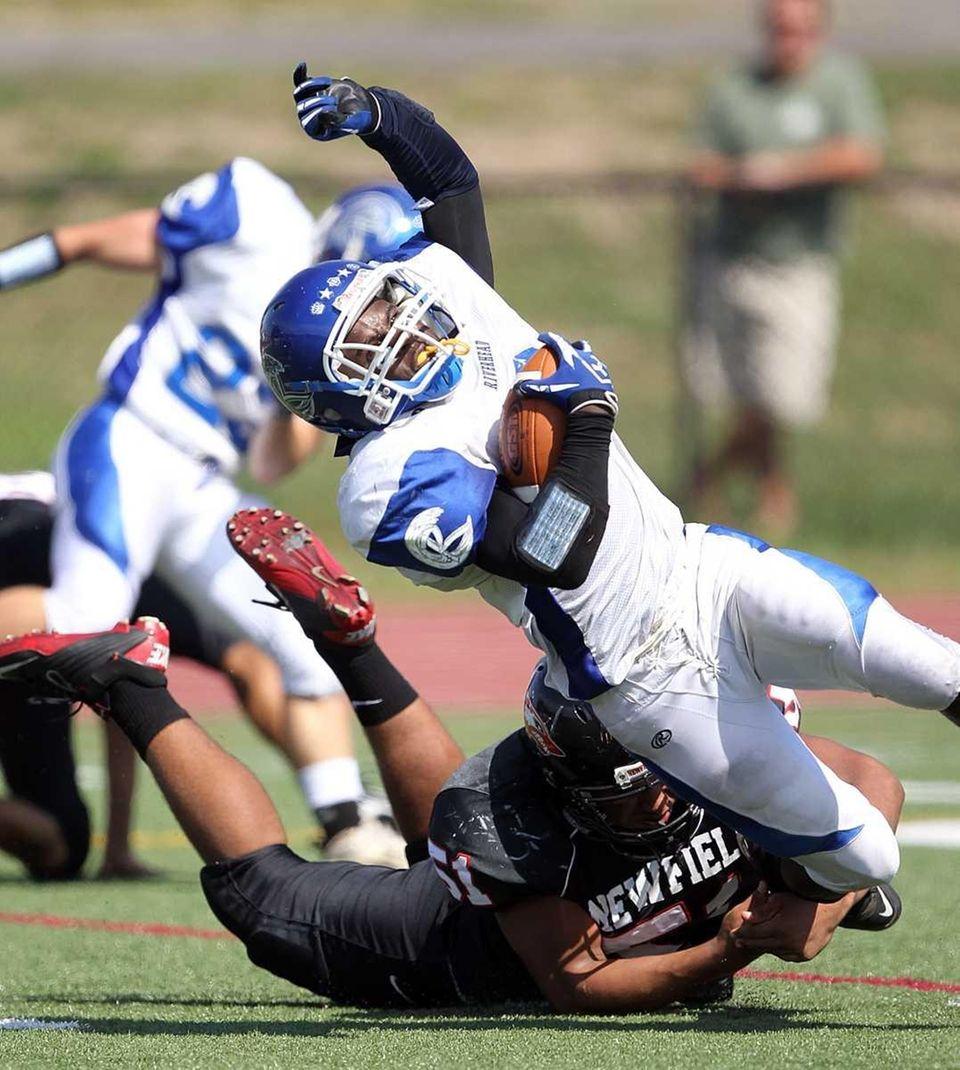 Newfield linebacker Julian Santiago makes an open-field tackle