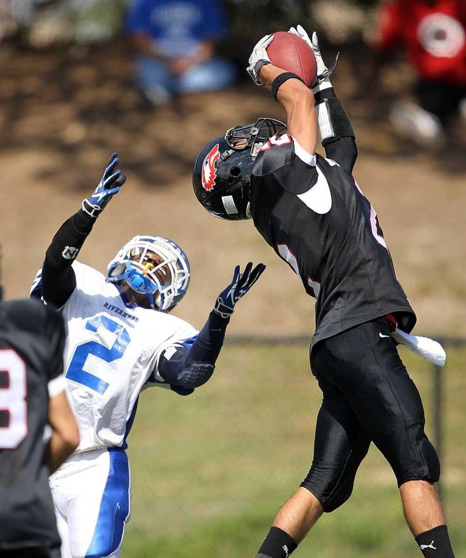 Newfield defensive back Mike Lopes-Silva intercepts a pass