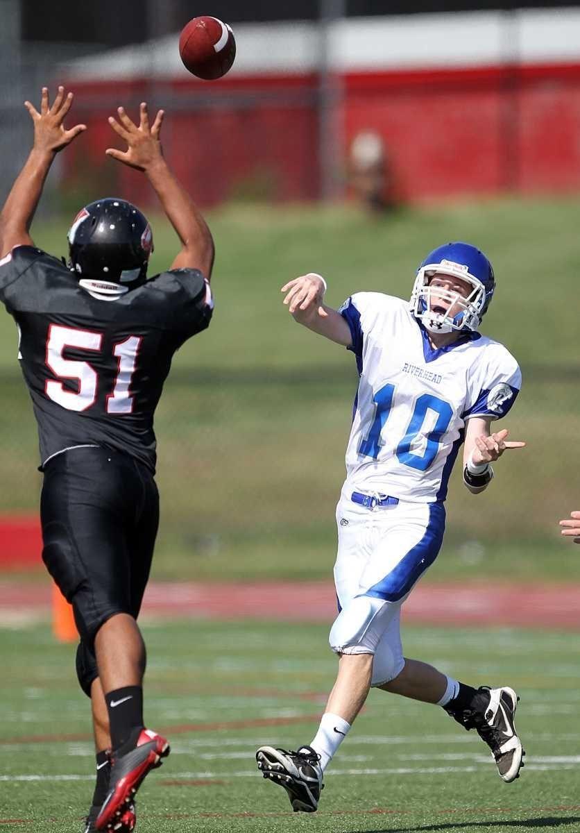 Riverhead quarterback Ryan Bitzer lofts a pass over