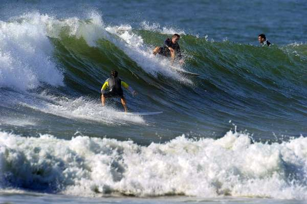 At Lido Beach West, surfers catch large waves