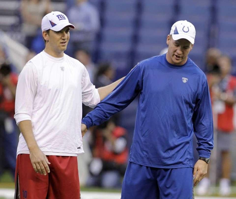 Giants quarterback Eli Manning, left, and Colts quarterback