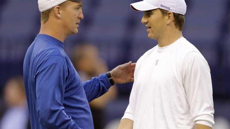 Colts quarterback Peyton Manning, left, and his brother,
