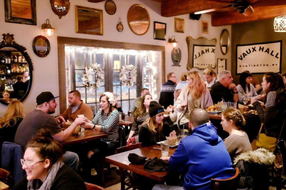 Patrons sip drinks chat and dine in the