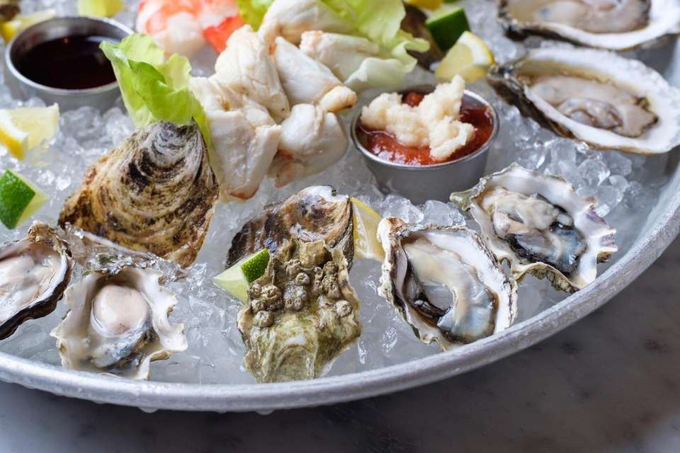 The oyster sampler features blue point, kumamoto, merry,