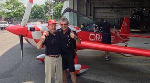 Bill Domjan, left, with Sean Tucker, pilot of