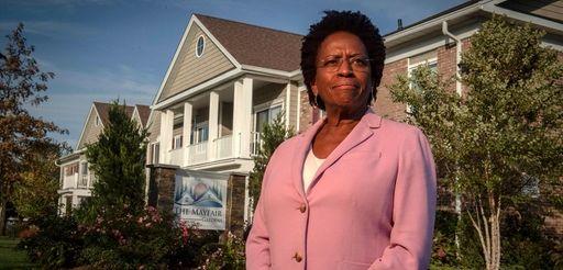 Elaine Gross, president of ERASE Racism, near Commack's