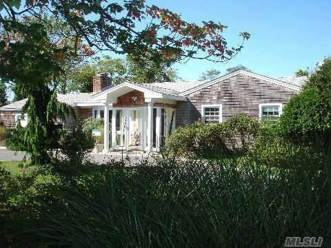 This four-bedroom, three-bathroom expanded ranch in Westhampton Beach,