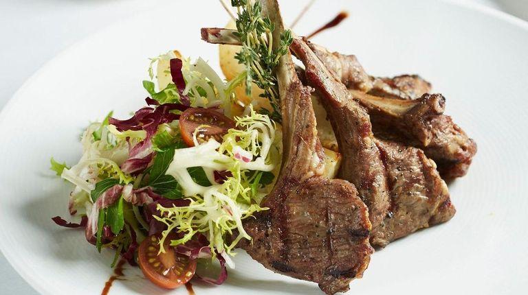 Lamb chops are perfumed with garlic and rosemary