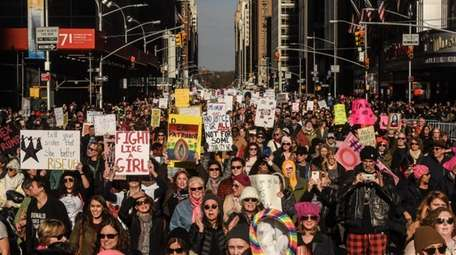 Women's March on NYC participants make their way