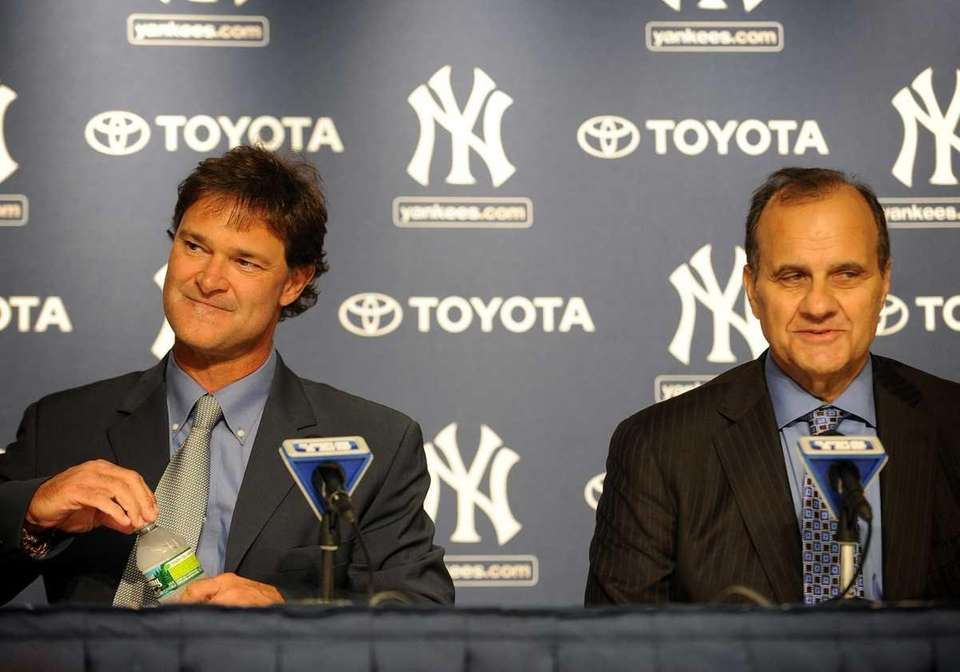 Don Mattingly, left, and Joe Torre at Yankee