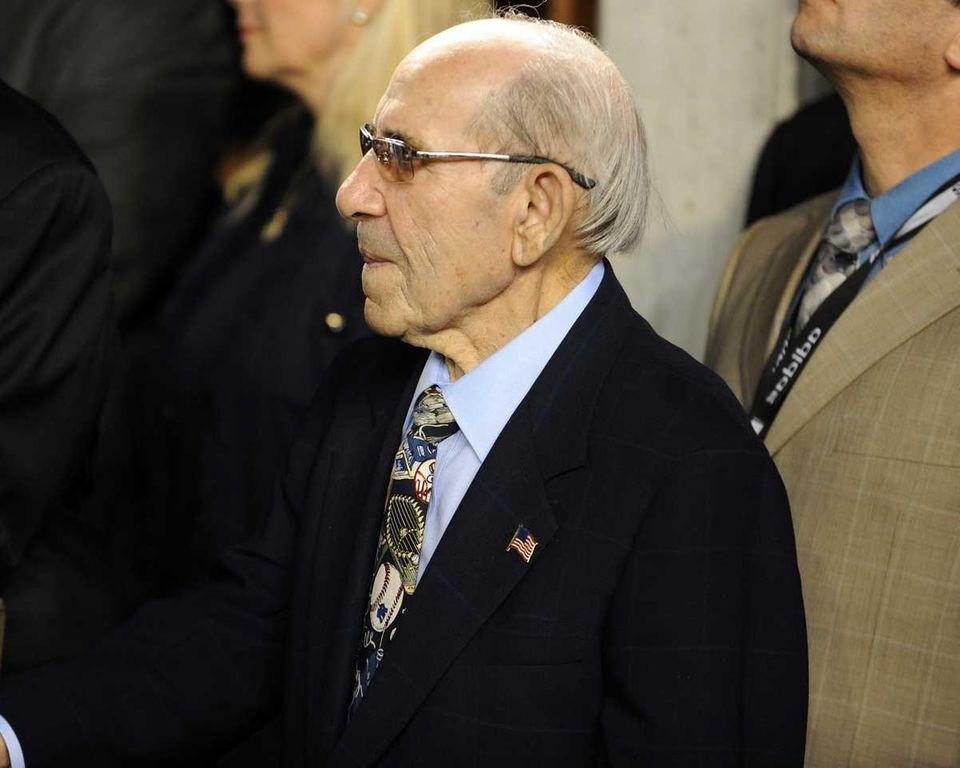 Yankees Hall of Famer Yogi Berra watches a