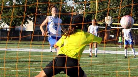 Division's Krista Fitzpatrick scores a penalty kick goal