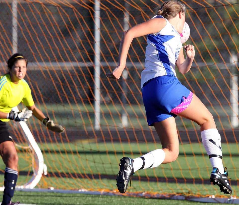 Division's Susan Ballantyne, right, scores a goal during