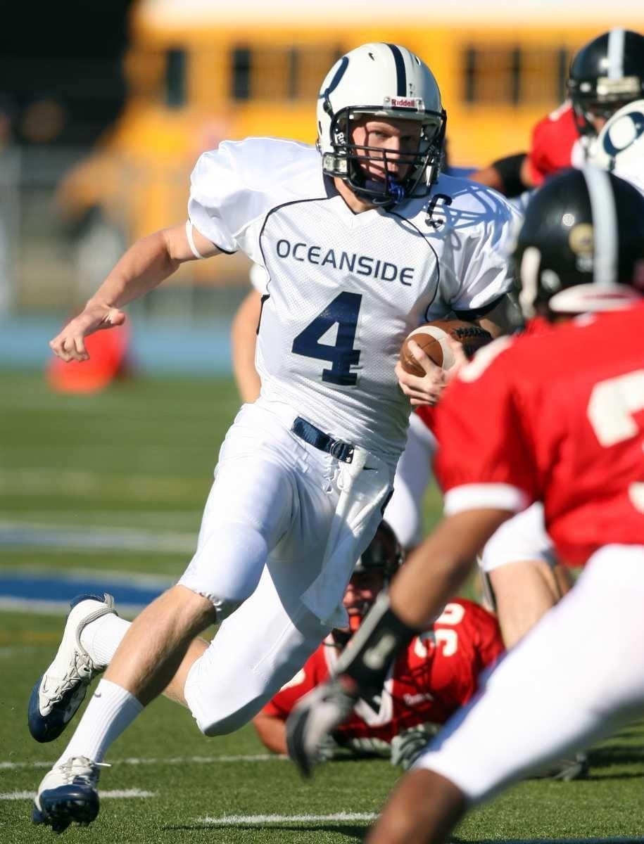 Oceanside quarterback Tyler Heuer dashes for yardage during